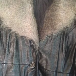 Faux leather and faux fur collar lined coat.
